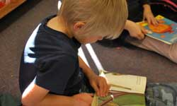 Photograph: Preschool boy reading