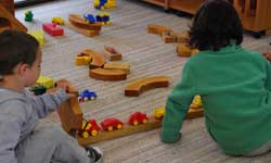 Photograph: Koori preschool students playing with wooden construction pieces