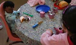 Photograph: Koori Preschool student playing in home corner
